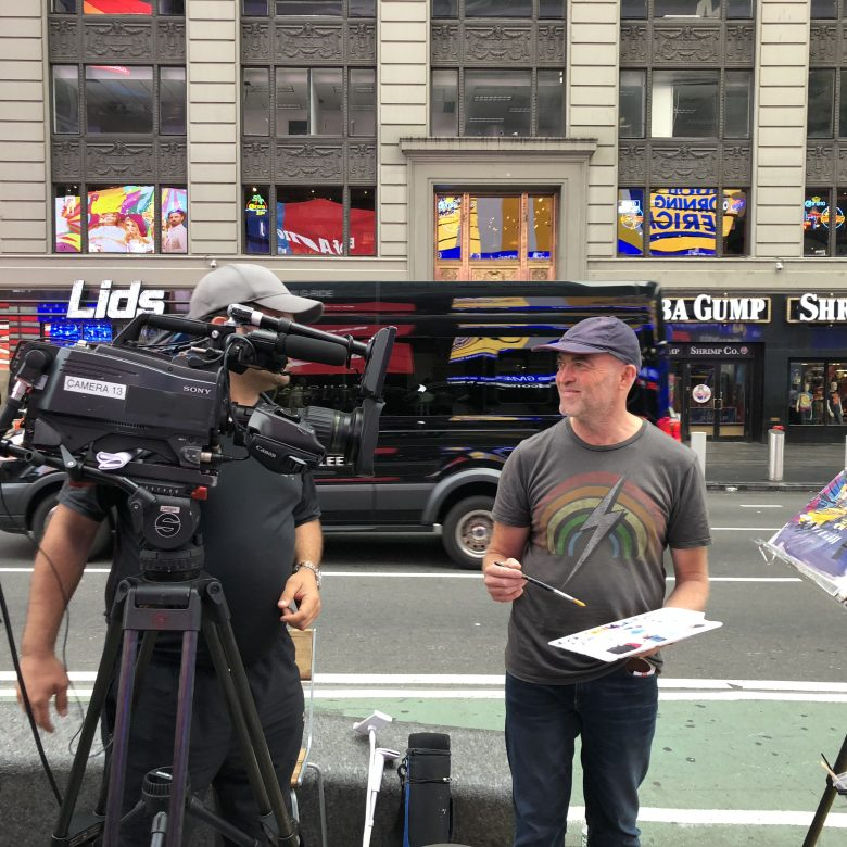 Paul Kenton, UK contemporary cityscape artist, being filmed by Good Morning America as he sketches on location in New York in preparation for a collection of new original paintings